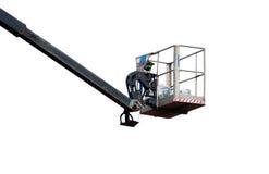 den isolerade tunga utrustningmaskinen för den hydrauliska elevatorn fungerar Fotografering för Bildbyråer