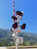 Den järnväg korsningen signalerar Arkivfoton