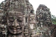 Den jätte- stenen vänder mot på Prasat Bayon, Angkor Wat Arkivfoto
