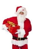 den julclaus gåvan hands lyckliga rymmande santa arkivbilder