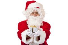 den julclaus gåvan hands lyckliga rymmande santa royaltyfri fotografi