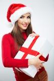 Den julSanta hatten isolerade gåvan för jul för kvinnaståendehållen Arkivbild