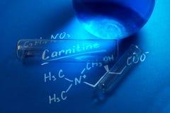 Den kemiska formeln av carnitine arkivbild