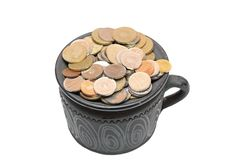 Den keramiska krukan som fylls med, myntar Royaltyfri Bild