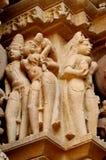 Den Khajuraho tempelgruppen av monument i IndiaSandstone skulpterar i Khajuraho tempelgrupp av monument i Indien Royaltyfria Bilder