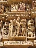 Den Khajuraho tempelgruppen av monument i IndiaSandstone skulpterar i Khajuraho tempelgrupp av monument i Indien Arkivbilder