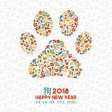Den kinesiska hunden för nytt år 2018 tafsar symbolsformkortet royaltyfria bilder