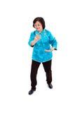 Den kinesiska kvinnan utför Tai-Chi Fotografering för Bildbyråer