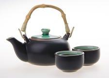 Den kinesiska teaseten med koppar och tea lägger in Fotografering för Bildbyråer