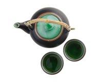 Den kinesiska teaseten med koppar och tea lägger in Royaltyfri Fotografi