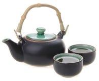 Den kinesiska teaseten med koppar och tea lägger in Royaltyfri Foto