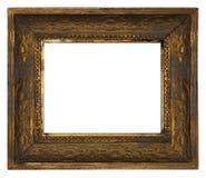 Den klassiska gamla utsmyckade träbildramen sned vid handen på vit bakgrund Arkivbild