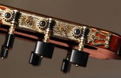 den klassiska gitarren heads maskinen Royaltyfria Bilder