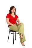 den knubbiga flickan sitter stolen Arkivbild