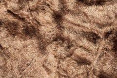 Den konstgjorda björnen pälsfodrar bakgrund texturerar Arkivbild