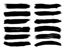 Den konstnärliga grungy svarta målarfärghanden - gjorde den idérika borsteslaglängden vektor illustrationer
