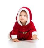 Den krypa litet barn Santa Claus behandla som ett barn flickan Arkivbild