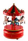 Den kulöra karusellen leker med upp hästar tätt, isolerad vit bakgrund Royaltyfri Foto