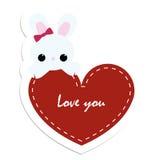 Den kulöra klistermärkekaninen med röd hjärta älskar jag dig emblem lappnolla Royaltyfria Foton
