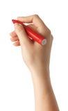 Den kvinnliga handen är klar för att dra med den röda markören isolerat Royaltyfri Foto