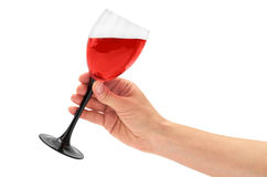 Den kvinnliga handen rymmer rött vin i exponeringsglas bakgrund isolerad white Arkivfoton