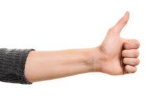 Den kvinnliga handen som gör tummar gör en gest upp Royaltyfri Bild