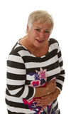 Den kvinnliga pensionären med magen smärtar Royaltyfria Foton