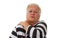 Den kvinnliga pensionären med halsen smärtar Royaltyfri Fotografi
