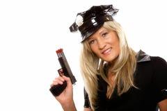 Den kvinnliga polisen för stående med det isolerade vapnet Royaltyfri Fotografi