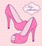 Den kvinnliga rosa färg skor Arkivbild