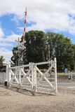 Den Kyneton järnvägsstationen har den sista uppsättningen av mekaniskt gripa in i varandra gungaportar i Victoria Arkivfoto