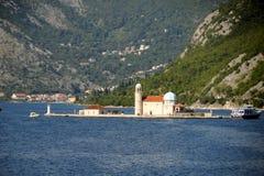 Den kyrkliga damen av vaggar Boka Kotorska arkivbilder