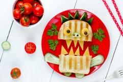 Den läckra smörgåsen som ett monster för ungar festar Rolig skolalun Royaltyfria Foton