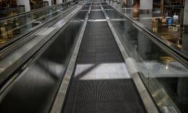 Den långa rörande trottoaren Royaltyfria Bilder