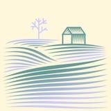 Den lantliga vintern landskap med sätter in och huset Arkivfoto