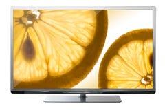 Tv:n med frukt avskärmer på Fotografering för Bildbyråer