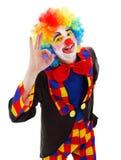 Clownvisningoken undertecknar fotografering för bildbyråer