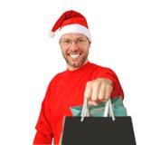 Den le julen man slitage av en santa hatt Arkivfoto