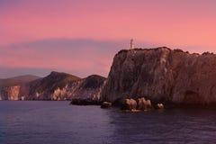 Den Lefkada fyren, Grekland, i härligt mjukt magentafärgat ljus royaltyfri bild