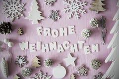 Den lekmanna- lägenheten, Frohe Weihnachten betyder glad jul, ram royaltyfri foto