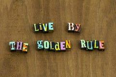 Den levande gyllene regeln gör till andra vänlighet arkivbilder