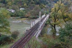 Den lilla järnvägsbron över floden, Georgia Arkivbilder