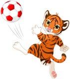 Den lilla tigern slår bollen vektor illustrationer