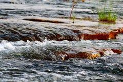 Den lilla vattennedgången gillar fotografering för bildbyråer