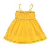 Den ljusa gula singleten behandla som ett barn Arkivfoto