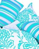 den ljusa samlingen cushions turkos royaltyfria bilder