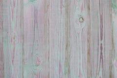 Den ljusa texturen av de gamla träplankorna knäckte och med stycken av torkad målarfärg, abstrakt bakgrund som var retro, Arkivfoton