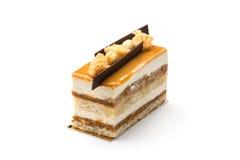 Den ljusbruna kakan med förtätat mjölkar och choklad Arkivbild