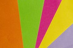 Den ljust guling, rosa färger, gräsplan, apelsinen och lilapapper texturerar tillbaka Royaltyfri Bild