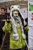 den london maskeringen upptar personen som protesterar Royaltyfri Foto